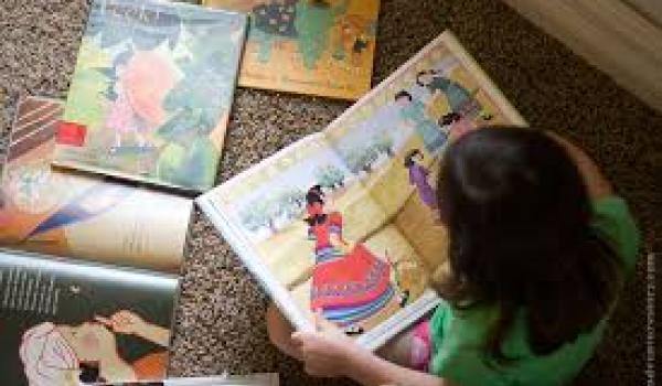 Girl reading picture books